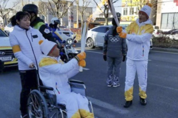 Disabled Chinese boy takes part in Winter Olympics torch rally