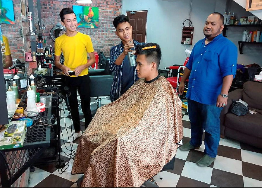 Kubang Kerian barbershop offers free haircut for senior citizens, people with disabilities