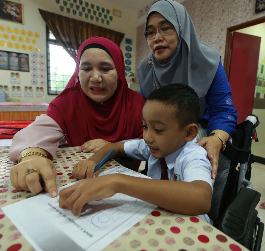 Year One pupil Aiman resolutely attends school despite disability