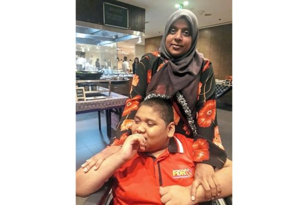 Buka puasa treat for the needy and the disabled