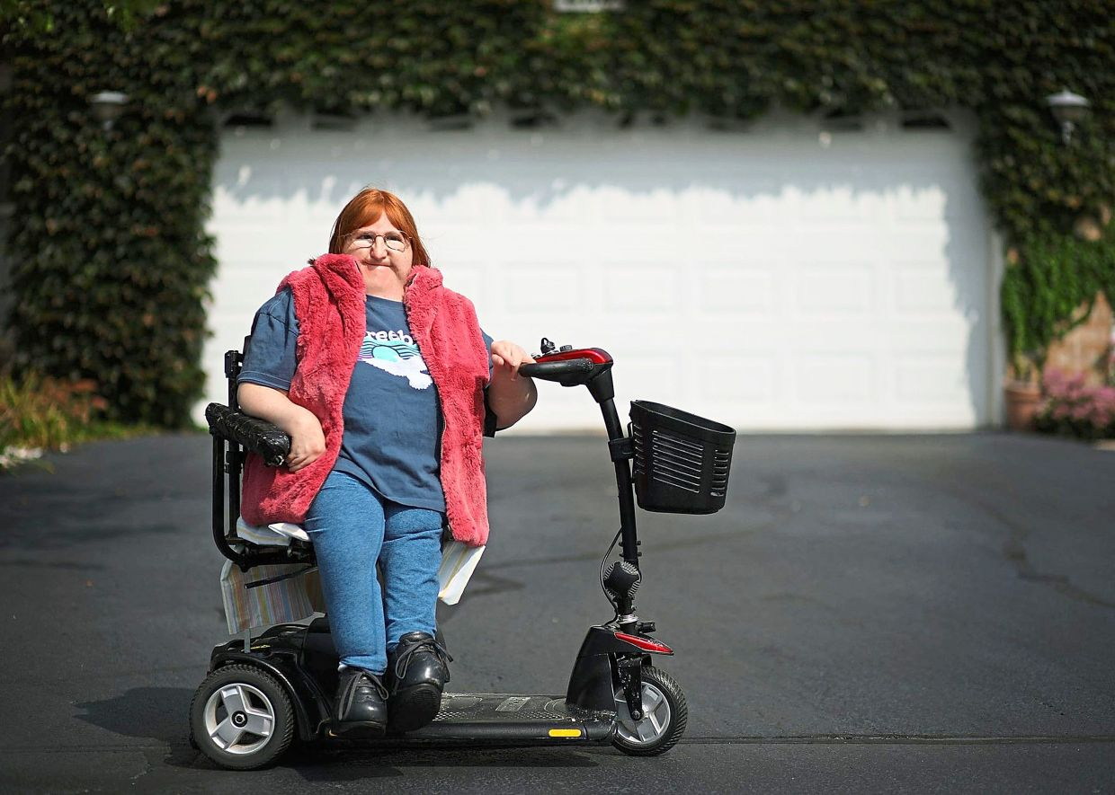 US disability activist takes to runway to promote access for disabled people